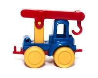Het hijsen van kraanstuk speelgoed op een witte geïsoleerde achtergrond, Stock Afbeeldingen