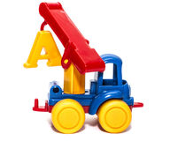 Het hijsen van kraanstuk speelgoed op een witte geïsoleerde achtergrond, Royalty-vrije Stock Afbeeldingen