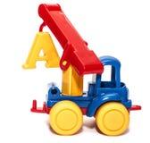 Het hijsen van kraanstuk speelgoed op een witte geïsoleerde achtergrond, Stock Foto's