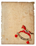 Het hobbelpaardstuk speelgoed van de Kerstmisdecoratie met oude document pagina Royalty-vrije Stock Fotografie