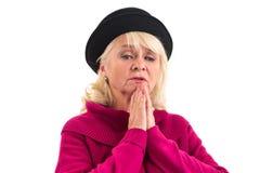 Het hogere dame geïsoleerd bidden royalty-vrije stock fotografie