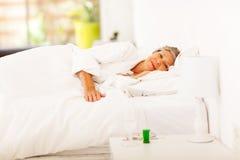 Het hogere vrouw rusten Stock Foto