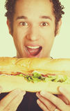 Het hongerige mens eten stock afbeelding