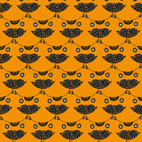 Het hoofd naadloze patroon van de leuke kat op een oranje achtergrond Stock Foto's