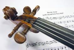Het hoofd van de viool met bladmuziek Royalty-vrije Stock Afbeeldingen