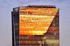 Het hoofdkwartier van ING Boekarest bij zonsondergang Stock Foto
