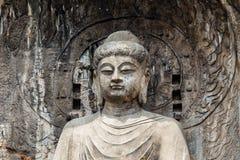 Het hoofdstandbeeld van Boedha in Fengxiangsi-Hol, belangrijkste in de Longmen-Grotten in Luoyang, Henan, China stock fotografie