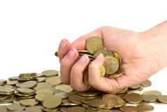 Het hoogtepunt van de hand van muntstukken Stock Afbeeldingen