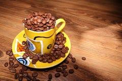 Het hoogtepunt van de kop van coffebonen stock foto's