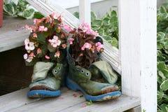 Het hoogtepunt van laarzen van bloemen Stock Foto's