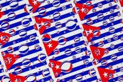 Het hoogtepunt van regendalingen van Cubaanse vlaggen Stock Foto