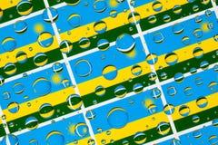 Het hoogtepunt van regendalingen van de vlaggen van Rwanda stock fotografie
