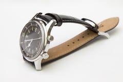 Het horloge van de de luxeduiker van mensen met leerriem op wit wordt geïsoleerd dat Stock Foto