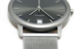 Het Horloge van het titanium op Wit Stock Afbeelding