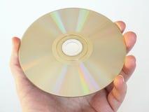 Het houden van CD, een CD-rom of een DVD Stock Afbeeldingen