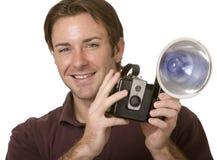 Het houden van een Camera royalty-vrije stock afbeelding