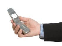 Het houden van een celtelefoon Stock Foto