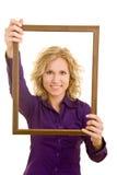 Het houden van een frame Stock Afbeeldingen