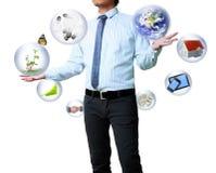 Het houden van een gloeiende bol en een technologie Stock Afbeeldingen