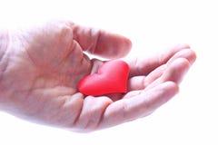 Het houden van een hart stock foto's