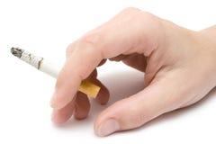 Het houden van een Sigaret Stock Foto