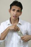 Het houden van geld in de zak Royalty-vrije Stock Foto's