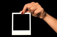 Het houden van lege polaroid Stock Afbeeldingen
