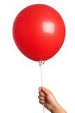 Het houden van rode ballon royalty-vrije stock foto's