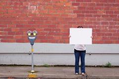 Het houden van Wit Teken stock fotografie