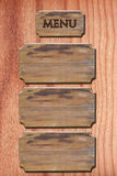 Het hout van het menu op houten muur stock fotografie