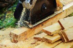 Het hout van machtszagen Stock Foto's