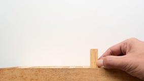 Het houten blok van de handduw Stock Fotografie