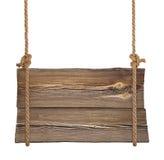 Het houten teken hangen op kabels Stock Afbeeldingen