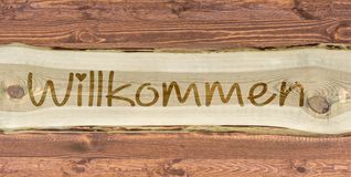 Het houten van letters voorzien met het Duitse woord voor onthaal als inschrijving royalty-vrije stock foto