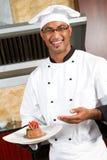 Het huidige voedsel van de chef-kok Royalty-vrije Stock Foto's