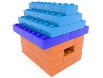 Het huis bouwt van stuk speelgoed bakstenen royalty-vrije illustratie