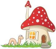 Het huis en de worm van de paddestoel royalty-vrije illustratie