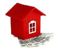 Het huis en het geld van het stuk speelgoed Stock Afbeelding