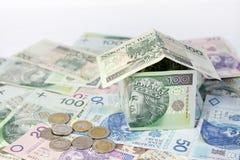 Het huis maakte ââof het krediet en de bouw van het poetsmiddelgeld Stock Afbeeldingen