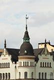 Het huis met een torentje en een windwijzer Stock Foto