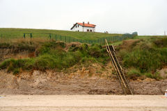 Het huis op het strand stock foto's