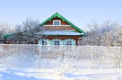 Het huis in sneeuw Stock Foto's