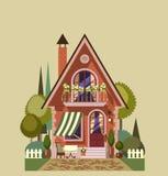 Het huis van de baksteen met tuin Stock Afbeeldingen