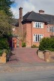 Het huis van de baksteenfamilie. Stock Afbeelding