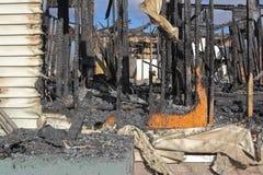 Het huis van de brandwond uit royalty-vrije stock afbeeldingen