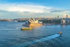 Het Huis van de Opera van Sydney bij zonsondergang Stock Foto's