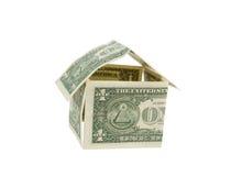 Het huis van het geld dat van dollarrekeningen wordt gemaakt stock fotografie