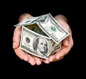 Het huis van het geld in handen Stock Afbeelding