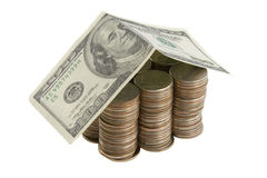 Het huis van het geld van muntstukken en dollars Stock Fotografie
