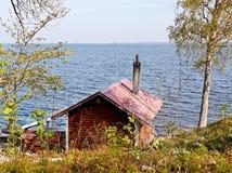 Het huis van het meer. Stock Foto
